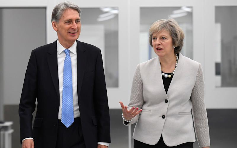 Philip Hammond and Theresa May - Credit: Toby Melville/PA