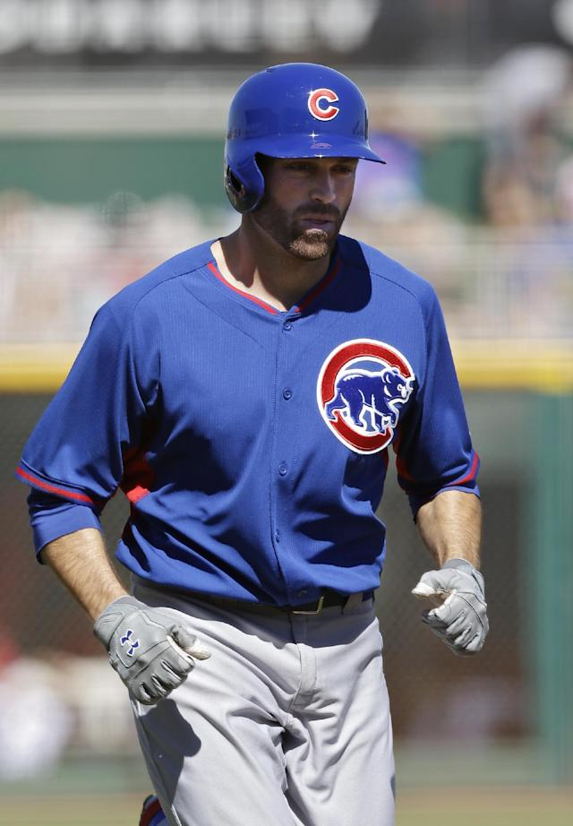 Chicago Cubs' Nate Schierholtz trots home after his two-run home run off Cincinnati Reds starting pitcher Alfredo Simon in the first inning of a spring training exhibition baseball game Saturday, March 8, 2014, in Goodyear, Ariz. (AP Photo/Mark Duncan)