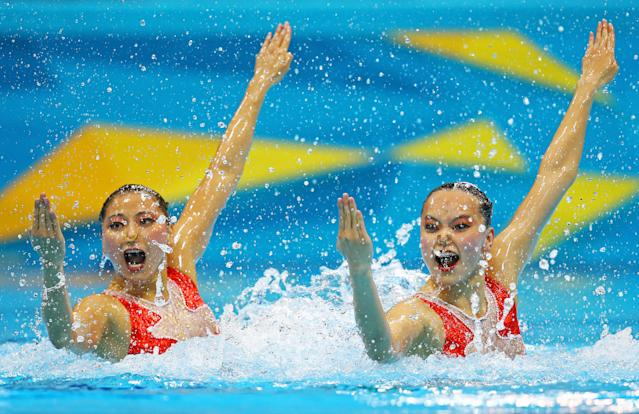 LONDON, ENGLAND - AUGUST 05: Xuechen Huang and Ou Liu of China compete in the Women's Duets Synchronised Swimming Technical Routine on Day 9 of the London 2012 Olympic Games at the Aquatics Centre on August 5, 2012 in London, England. (Photo by Al Bello/Getty Images)