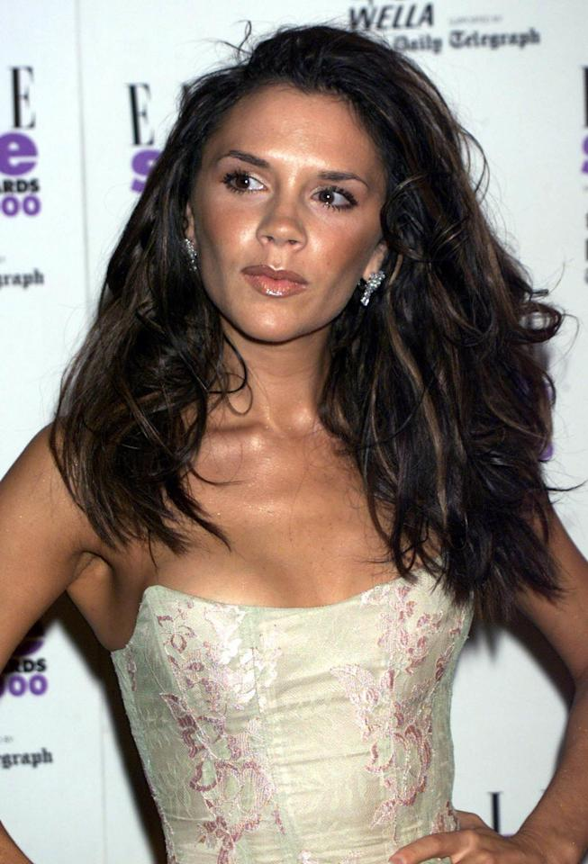 <p>Wearing her hair swept over in voluminous, tousled waves with a nude glossy lip, Beckham attends the Elle Style Awards in London. (2000)</p>