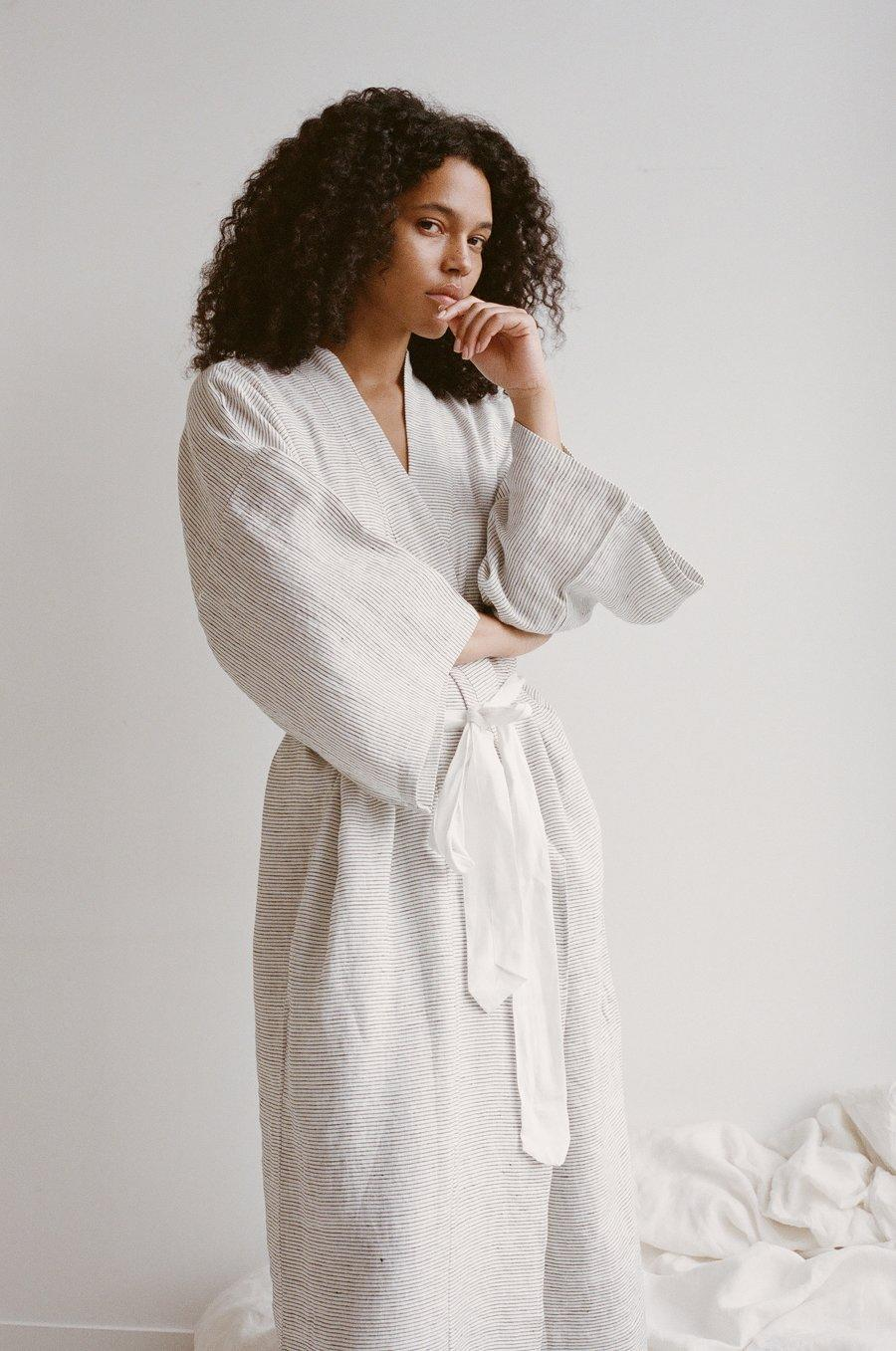 """<p>A French linen lining makes this <a href=""""https://www.marthastewart.com/7753406/best-loungewear"""" rel=""""nofollow noopener"""" target=""""_blank"""" data-ylk=""""slk:luxe lounging robe"""" class=""""link rapid-noclick-resp"""">luxe lounging robe</a> feel as light as a feather against your skin. The biodegradable garments are also made using a """"slow fashion"""" production model in a warehouse that operates sustainably on every front, from how and where it ships products to internal climate control. And when you buy products from Deji Studios, they will be shipped to your home in compostable packaging, which means their offerings are green from start to finish.</p> <p><strong><em>Shop Now: </em></strong><em>Deji Studios Pinstripe Robe, $139, </em><a href=""""https://deijistudios.com/collections/robes/products/the-02-full-length-robe-in-pinstripe"""" rel=""""nofollow noopener"""" target=""""_blank"""" data-ylk=""""slk:dejistudios.com"""" class=""""link rapid-noclick-resp""""><em>dejistudios.com</em></a><em>.</em></p>"""