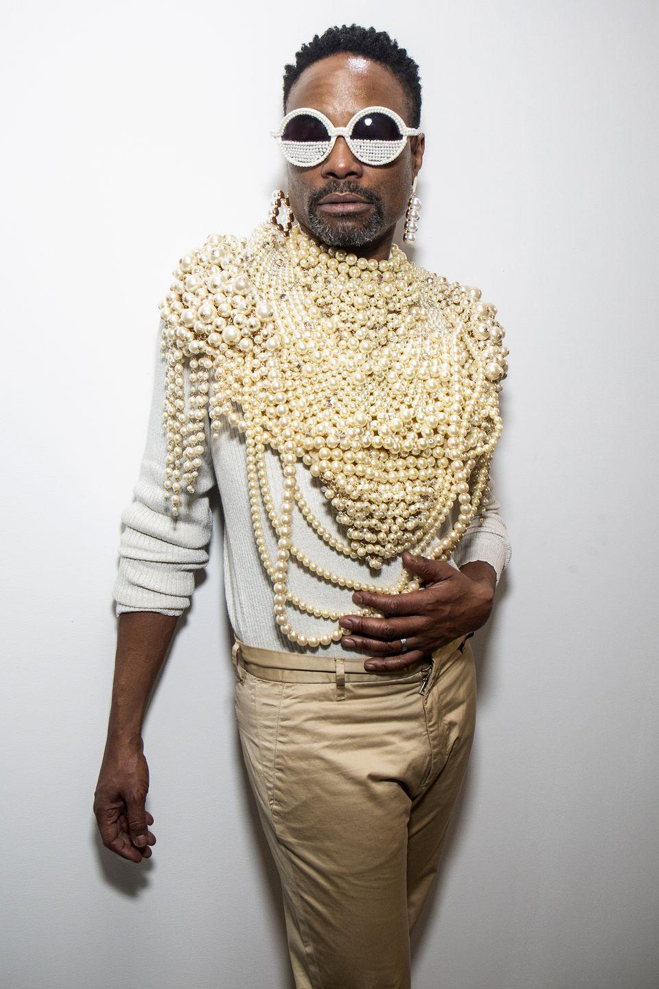 <p>At NYFW show at Spring Studios, Porter wore the brand's pearl necklace, taking his gold-coloured trousers, white long-sleeved jumper and white pearl-encrusted sunglasses ensemble to the next level. </p>