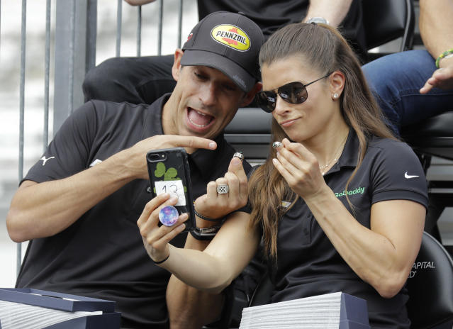 Tony Kanaan, of Brazil, and Danica Patrick take a selfie with their rings during the drivers meeting for the Indianapolis 500 auto race at Indianapolis Motor Speedway, in Indianapolis Saturday, May 26, 2018. (AP Photo/Darron Cummings)