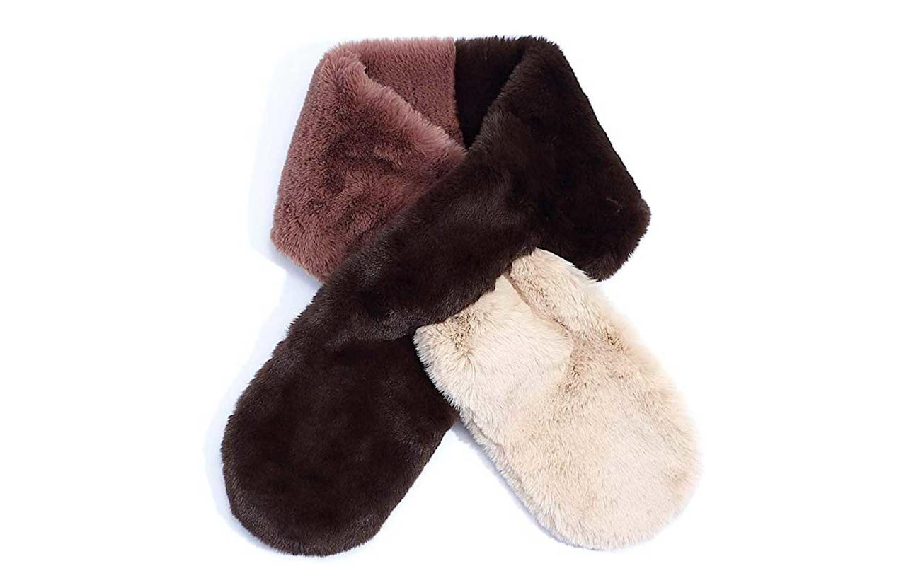 """<p>This glamorous faux fur scarf was selected for Oprah's Favorite Things 2019, and it's easy to see why. It provides plenty of warmth while also adding a pop of color to any winter coat.</p> <p>To buy: <a href=""""https://www.amazon.com/dp/B07YGT4849/ref=as_li_ss_tl?ie=UTF8&linkCode=ll1&tag=tlfascoldweatheraccessoriesmdiamondnov19-20&linkId=a803e6d446747d5e29a27765568fc702&language=en_US"""">amazon.com</a>, $59</p>"""