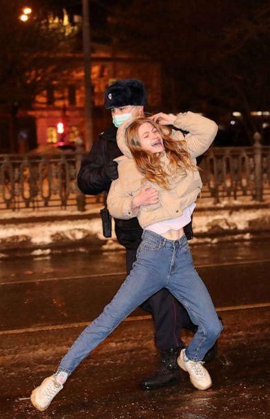 PHOTO: A law enforcement officer detains a woman during a rally in support of jailed Russian opposition leader Alexey Navalny in Moscow, Jan. 23, 2021. (Evgenia Novozhenina/Reuters)