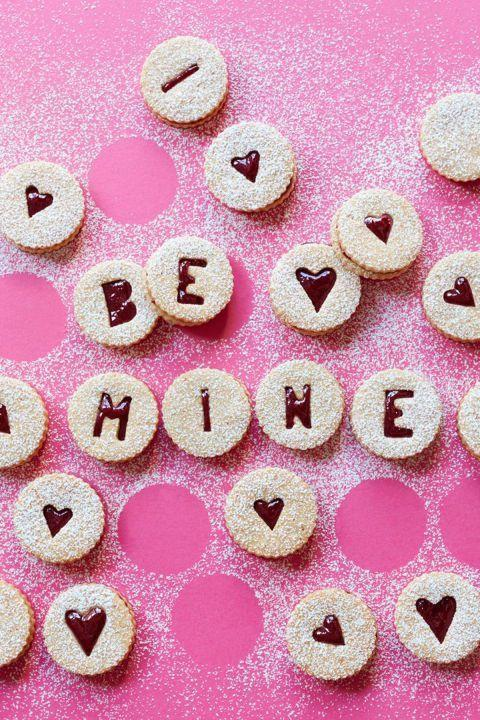 """<p>Make your own conversation hearts with these jammy cookies.</p><p><a class=""""link rapid-noclick-resp"""" href=""""https://www.amazon.com/Fox-Run-3605-Stainless-6-Piece/dp/B0000VLOWM?tag=syn-yahoo-20&ascsubtag=%5Bartid%7C10055.g.3182%5Bsrc%7Cyahoo-us"""" rel=""""nofollow noopener"""" target=""""_blank"""" data-ylk=""""slk:SHOP COOKIE CUTTERS"""">SHOP COOKIE CUTTERS</a></p><p><em><a href=""""http://www.womansday.com/food-recipes/food-drinks/recipes/a53344/sweet-cherry-linzer-torte-cookies/"""" rel=""""nofollow noopener"""" target=""""_blank"""" data-ylk=""""slk:Get the recipe from Woman's Day"""" class=""""link rapid-noclick-resp"""">Get the recipe from Woman's Day </a></em> </p>"""