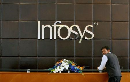 An employee of Infosys stands at the front desk of its headquarters in Bengaluru, India, April 15, 2016.   REUTERS/Abhishek N. Chinnappa/File Photo