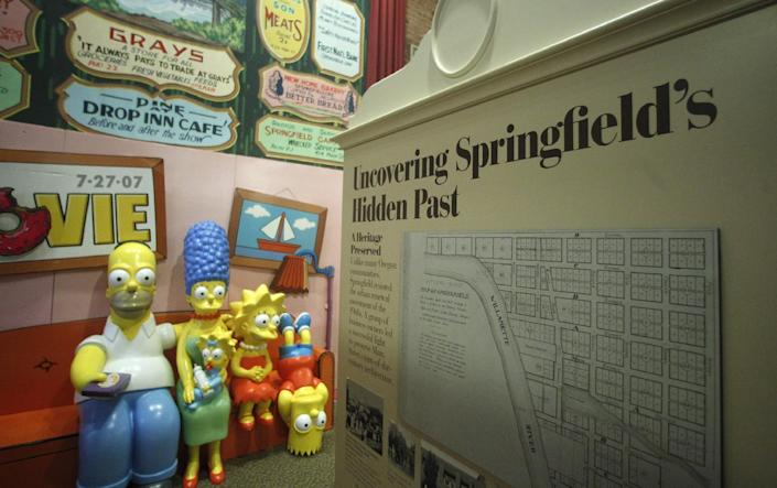 """The Simpsons Couch is on display at the Springfield Museum Tuesday, April 10, 2012, in Springfield, Ore. One of the best-kept secrets in television history has been revealed, with """"The Simpsons"""" creator Matt Groening pointing to Springfield, Ore., as the inspiration for the animated hometown of Homer and his dysfunctional family. Groening told Smithsonian magazine, published online Tuesday, that he was inspired by the television show """"Father Knows Best,"""" which took place in a place called Springfield. Springfield, Ore., is 100 miles south of Groening's hometown of Portland. (AP Photo/Rick Bowmer)"""