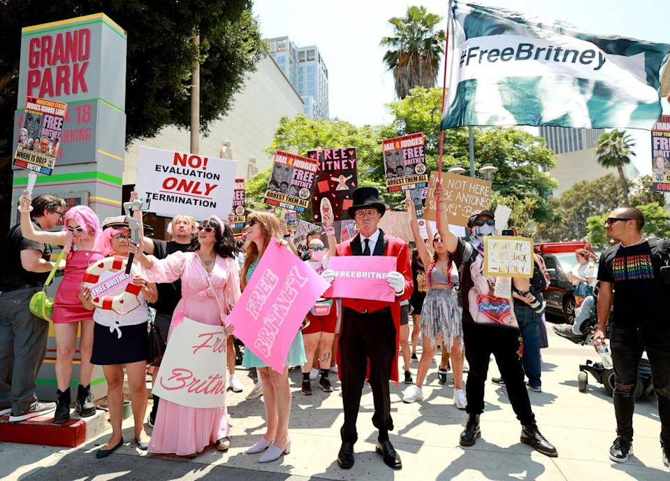 """<div class=""""inline-image__caption""""><p>Protesters attend a #FreeBritney Rally at Stanley Mosk Courthouse on July 14, 2021, in Los Angeles, California. </p></div> <div class=""""inline-image__credit"""">Emma McIntyre/Getty</div>"""