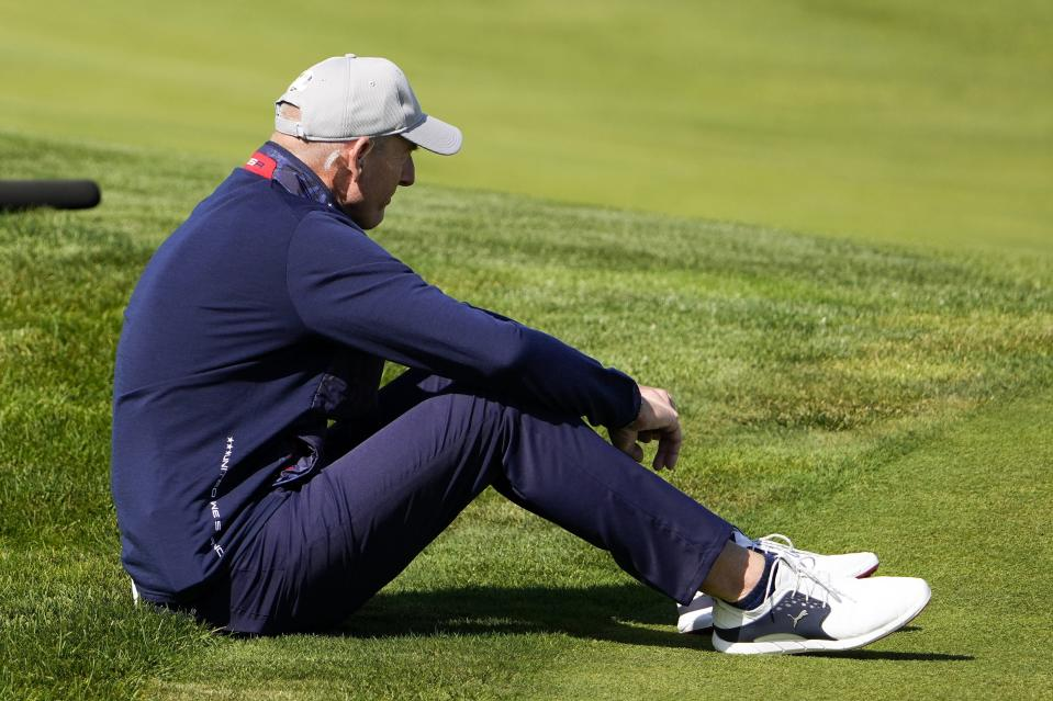Jim Furyk watches during a four-ball match the Ryder Cup at the Whistling Straits Golf Course Friday, Sept. 24, 2021, in Sheboygan, Wis. (AP Photo/Jeff Roberson)