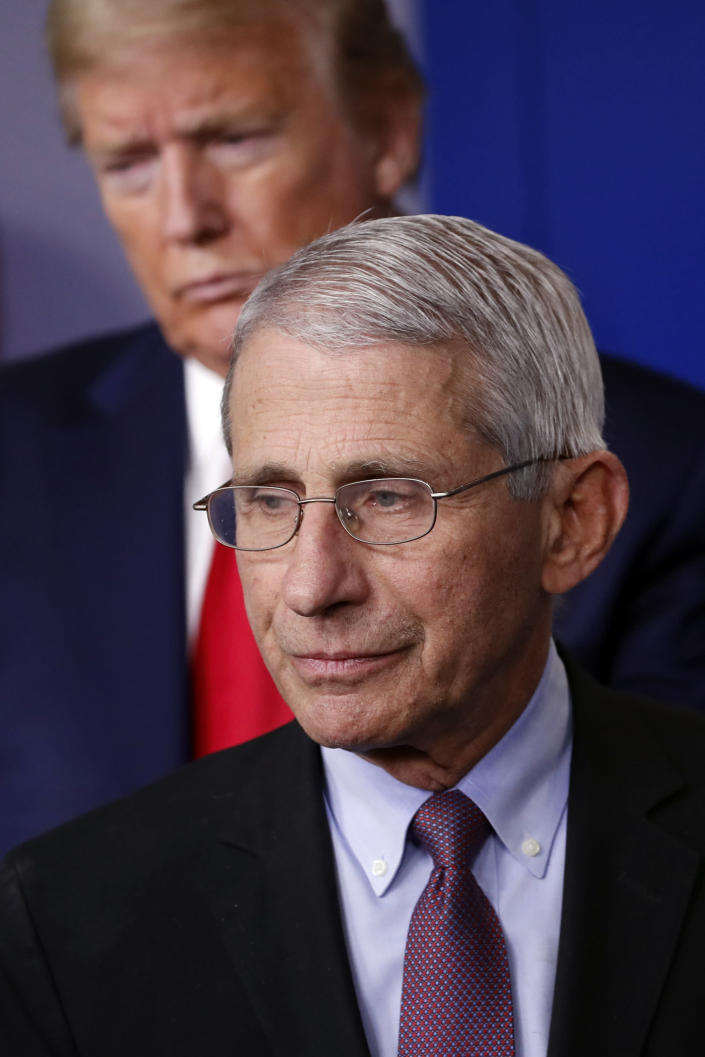 FILE - In this April 22, 2020, file photo President Donald Trump watches as Dr. Anthony Fauci, director of the National Institute of Allergy and Infectious Diseases, approaches the podium to speak about the coronavirus in the James Brady Press Briefing Room of the White House in Washington. (AP Photo/Alex Brandon, File)