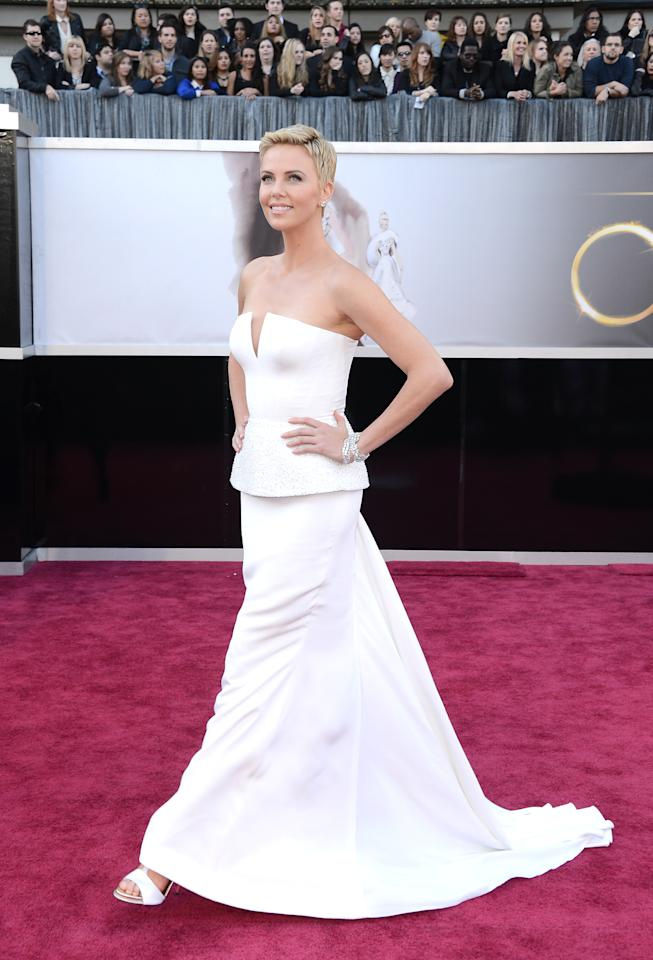 <p>Dior favourite Charlize Theron rocked up to the 2013 Academy Awards in a strapless white couture gown worth $100,000 (£72,000). The simple dress was worth enough on its own but the addition of a few Harry Winston diamond cuffs amped up the value to a huge $4 million (£3 million).<br /><i>[Photo: Getty]</i> </p>