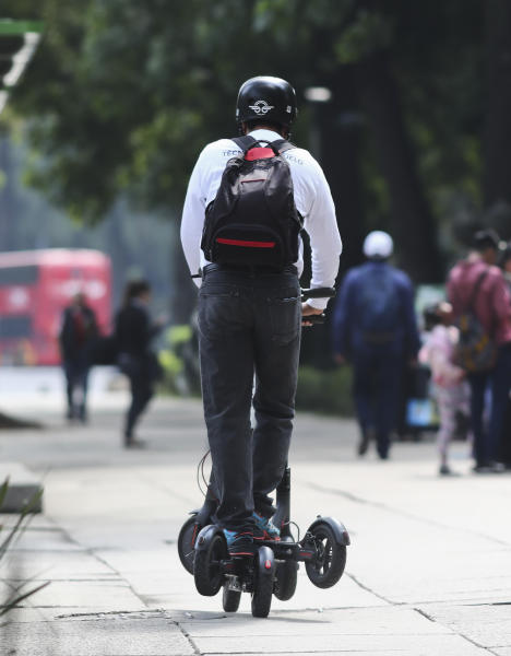 "A worker collects scooters that are left after being used on the sidewalk on Reforma Avenue, in Mexico City, Thursday, Aug. 1, 2019. An electric scooter firm has temporarily ceased operations in Mexico City because so many of its two-wheeled units have been stolen. The Grin company said in a statement that ""at present, the theft of our scooters in Mexico City is the biggest challenge."" (AP Photo/Eduardo Verdugo)"