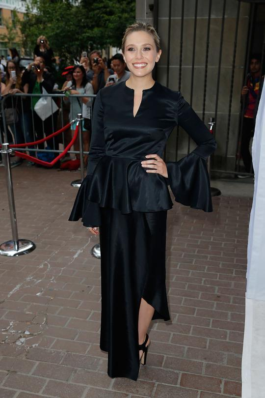"<p>Sisters Mary-Kate and Ashley Olsen, designers behind popular brands including The Row and Elizabeth & James, obviously aren't the only ones with a discerning sartorial eye in the family. At the premiere of ""I Saw The Light,"" actress Elizabeth Olsen wore a black satin gown with oversized bell sleeves. </p>"