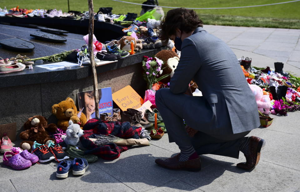FILE - In this June 1, 2021, file photo, Canadian Prime Minister Justin Trudeau visits a memorial at the Eternal Flame on Parliament Hill in Ottawa that's in recognition of discovery of children's remains at the site of a former residential school in Kamloops, British Columbia. Leaders of Indigenous groups in Canada say investigators have found more than 600 unmarked graves at the site of a former residential school for Indigenous children in Saskatchewan. That follows last month's discovery of about 215 bodies at another such school in British Columbia. (Sean Kilpatrick/The Canadian Press via AP, File)