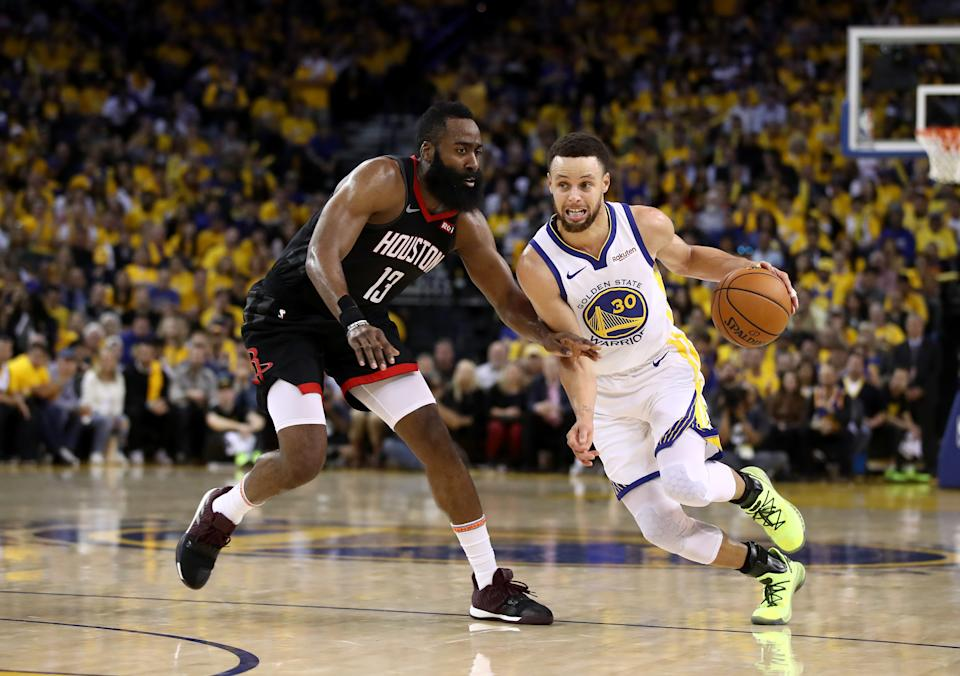 OAKLAND, CALIFORNIA - MAY 08:   Stephen Curry #30 of the Golden State Warriors dribbles past James Harden #13 of the Houston Rockets during Game Five of the Western Conference Semifinals of the 2019 NBA Playoffs at ORACLE Arena on May 08, 2019 in Oakland, California.  NOTE TO USER: User expressly acknowledges and agrees that, by downloading and or using this photograph, User is consenting to the terms and conditions of the Getty Images License Agreement.  (Photo by Ezra Shaw/Getty Images)