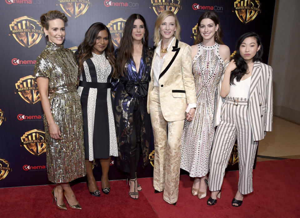 "Sarah Paulson, from left, Mindy Kaling, Sandra Bullock, Cate Blanchett, Anne Hathaway and Awkwafina, cast members in the upcoming film ""Ocean's 8,"" arrive at the Warner Bros. presentation at CinemaCon 2018. (Photo by Chris Pizzello/Invision/AP)"