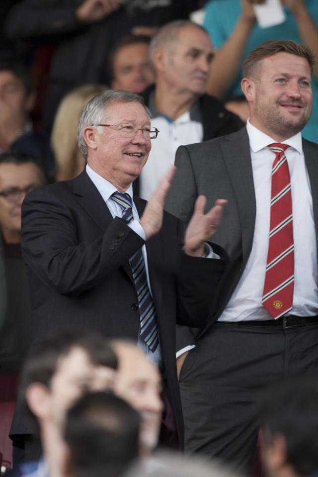 Manchester United's former manager Alex Ferguson applauds as he takes his seat before the side's English Premier League soccer match against Southampton at Old Trafford Stadium, Manchester, England, Saturday Oct. 19, 2013. (AP Photo/Jon Super)