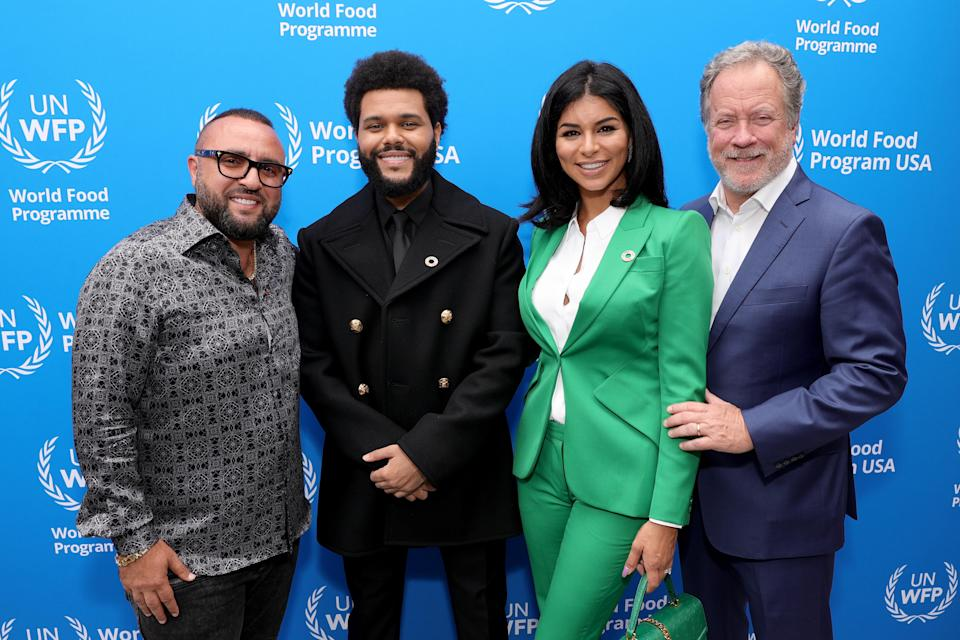 """WEST HOLLYWOOD, CALIFORNIA – OCTOBER 07: (L-R) Wassim """"Sal"""" Slaiby, The Weeknd, U.N. WFP USA Board of Directors Rima Fakih, and U.N. WFP Executive Director David Beasley attend the U.N. World Food Programme as it welcomes The Weeknd as a Goodwill Ambassador on October 07, 2021 in West Hollywood, California. (Photo by Rich Fury/Getty Images for U.N. World Food Programme) - Credit: Getty Images for U.N. World Food Programme"""