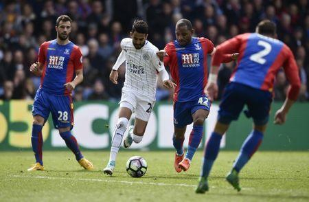 Britain Soccer Football - Crystal Palace v Leicester City - Premier League - Selhurst Park - 15/4/17 Leicester City's Riyad Mahrez in action with Crystal Palace's Jason Puncheon Reuters / Hannah McKay Livepic