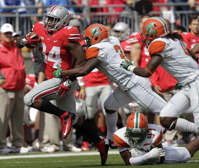 Ohio State running back Carlos Hyde, left, runs around the outside as Florida A&M defenders Devonte Terry Johnson, right, Akil Blount, bottom, and Devan Roberts try to tackle him during the second quarter of an NCAA college football game Saturday, Sept. 21, 2013, in Columbus, Ohio. (AP Photo/Jay LaPrete)