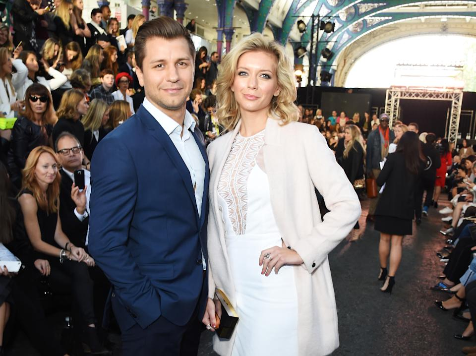 LONDON, ENGLAND - SEPTEMBER 19:  Rachel Riley (R) and Pasha Kovalev attend the Julien MacDonald Spring/Summer 2016 Collection during London Fashion Week at Smithfields Market on September 19, 2015 in London, England.  (Photo by David M. Benett/Getty Images for Julien MacDonald)