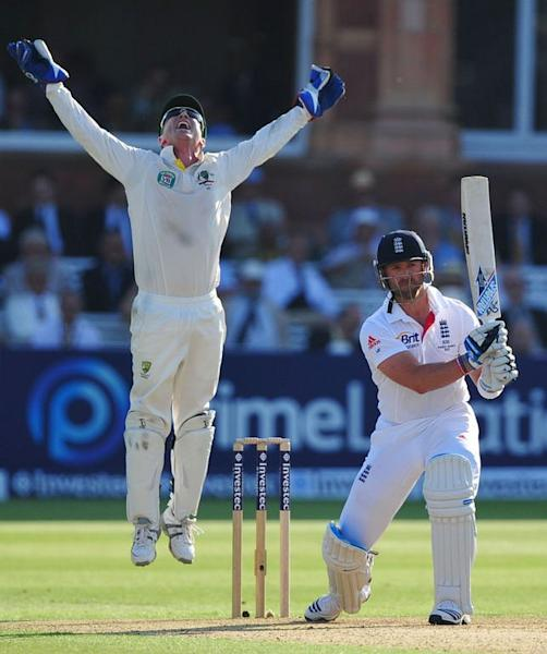 Australia's wicketkeeper Brad Haddin (L) celebrates after taking the catch to dismiss England's Matt Prior during the first day of the second Ashes Test match at Lord's cricket ground in north London on July 18, 2013
