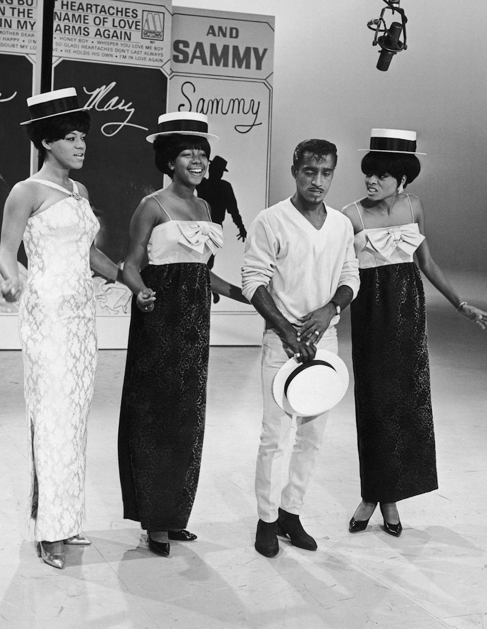 <p>Around this time, the Supremes began touring and making appearances on television shows. Here, they perform with Sammy Davis Jr. on a TV special. </p>
