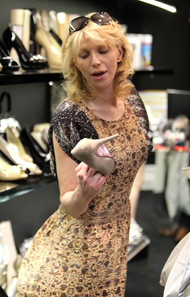 "While in Sydney, Australia, Courtney Love stopped at a posh shoe store where she eyed some seriously high pumps. Andy Athineos/<a href=""http://www.infdaily.com"" target=""new"">INFDaily.com</a> - August 3, 2011"