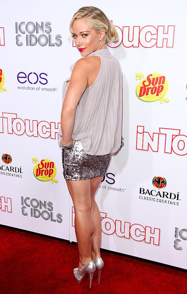 "Kendra Wilkinson simply sparkled in her sequined mini and silver pumps upon arriving at <i>In Touch</i> soiree, but it sounds like she may have had a little bit too much fun. On Friday morning, she tweeted that her 2-year-old son Hank ""came running into my room super early this morning. I was hurting so bad but that's what I get. Hahahha."" (9/6/2012)"