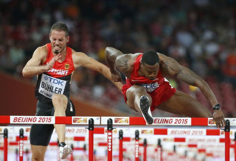 Matthias Buehler of Germany and David Oliver from the U.S. compete  in the men's 110m hurdles semi-final during the 15th IAAF World Championships at the National Stadium in Beijing, China August 27, 2015. REUTERS/Lucy Nicholson
