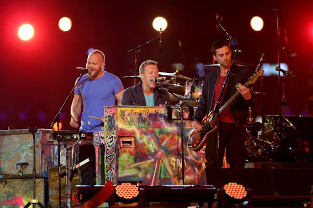 LONDON, ENGLAND - SEPTEMBER 09: (R-L) Guy Berryman, Chris Martin and Jonny Buckland of Coldplay perform during the closing ceremony on day 11 of the London 2012 Paralympic Games at Olympic Stadium on September 9, 2012 in London, England. (Photo by Peter Macdiarmid/Getty Images)