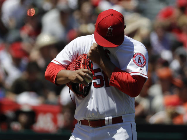 Los Angeles Angels starting pitcher Jaime Barria wipes his face during the first inning of a baseball game against the San Francisco Giants in Anaheim, Calif., Sunday, April 22, 2018. (AP Photo/Chris Carlson)