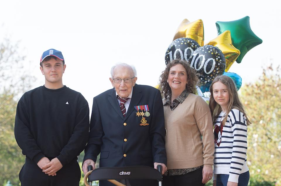 99-year-old war veteran Captain Tom Moore, with (left to right) grandson Benji, daughter Hannah Ingram-Moore and granddaughter Georgia, at his home in Marston Moretaine, Bedfordshire, after he achieved his goal of 100 laps of his garden - raising more than 12 million pounds for the NHS. (Photo by Joe Giddens/PA Images via Getty Images)