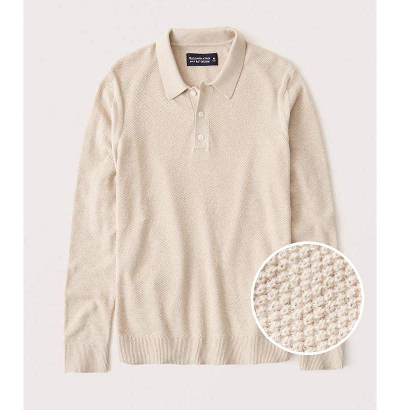 """<p><strong>Abercrombie & Fitch</strong></p><p>abercrombie.com</p><p><strong>$35.40</strong></p><p><a href=""""https://go.redirectingat.com?id=74968X1596630&url=https%3A%2F%2Fwww.abercrombie.com%2Fshop%2Fus%2Fp%2Fcotton-cashmere-long-sleeve-knit-polo-40823819&sref=https%3A%2F%2Fwww.esquire.com%2Fstyle%2Fmens-fashion%2Fg33032327%2Fcheap-july-4-sales-mens-fashion%2F"""" rel=""""nofollow noopener"""" target=""""_blank"""" data-ylk=""""slk:Buy"""" class=""""link rapid-noclick-resp"""">Buy</a></p><p>Instant """"Why yes,<em> I am</em> an adult, thank you for noticing"""" status, in sweater form. </p>"""