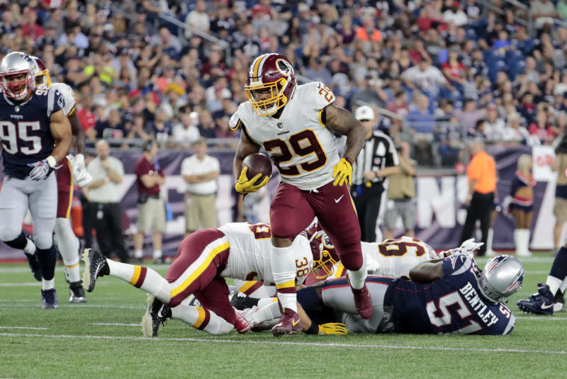 FOXBOROUGH, MA - AUGUST 09: Washington Redskins running back Derrius Guice (29) breaks through the line during a preseason NFL game between the New England Patriots and the Washington Redskins on August 9, 2018, at Gillette Stadium in Foxborough, Massachusetts. The Patriots defeated the Redskins 26-17. (Photo by Fred Kfoury III/Icon Sportswire via Getty Images)