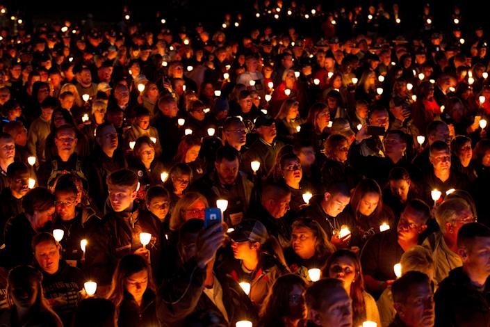 People hold candles during the National Law Enforcement Officers Memorial Fund annual vigil to commemorate names added to the monument at the National Mall in Washington on May 13, 2019.