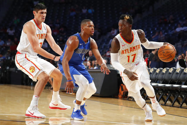 Dennis Schröder (right) will get his chance to prove that he's a foundational piece for a Hawks team in transition. (AP)