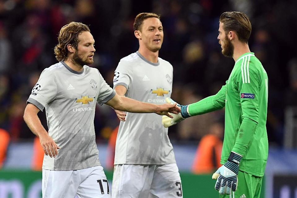 (From L) Manchester United's Daley Blind, Nemanja Matic and David De Gea celebrate after their UEFA Champions League Group A match against CSKA Moscow, in Moscow, on September 27, 2017 (AFP Photo/Kirill KUDRYAVTSEV)