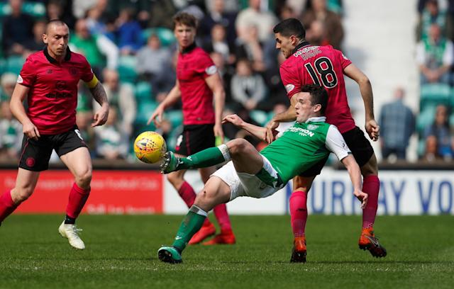 Soccer Football - Scottish Premiership - Hibernian v Celtic - Easter Road, Edinburgh, Britain - April 21, 2018 Hibernian's John McGinn in action with Celtic's Tom Rogic REUTERS/Russell Cheyne