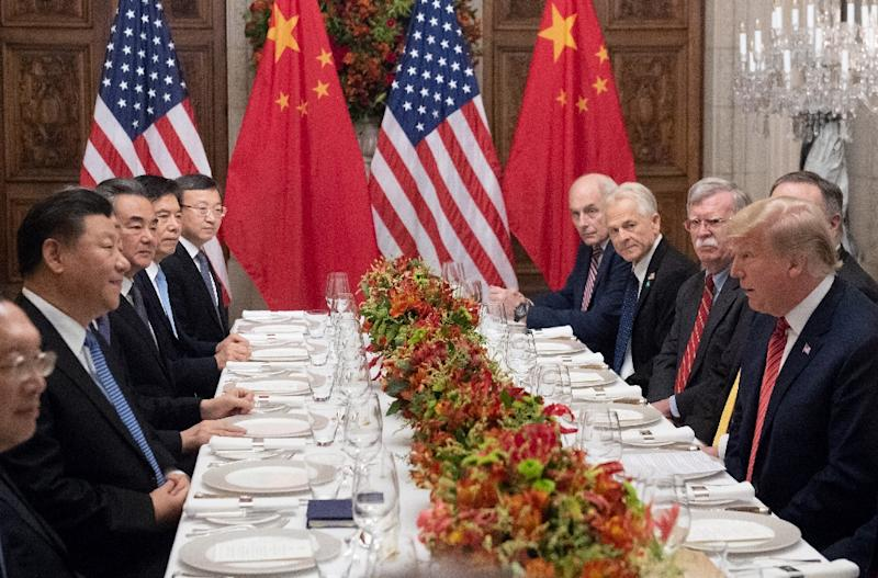 Uncertainty about trade relations between the US and China -- shown here at the G-20 in Argentina earlier this month -- have been a source of pressure for stocks US President Donald Trump (R) and China's President Xi Jinping (L) along with members of their delegations, hold a dinner meeting at the end of the G20 Leaders' Summit in Buenos Aires, on December 01, 2018.US President Donald Trump and his Chinese counterpart Xi Jinping had the future of their trade dispute -- and broader rivalry between the world's two top economies -- on the menu at a high-stakes dinner Saturday. (AFP Photo/SAUL LOEB)