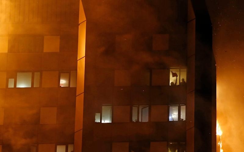 "Residents were trapped ""screaming for their lives"" as flames raged through a 27-storey tower block in Notting Hill - Credit: Eyevine"
