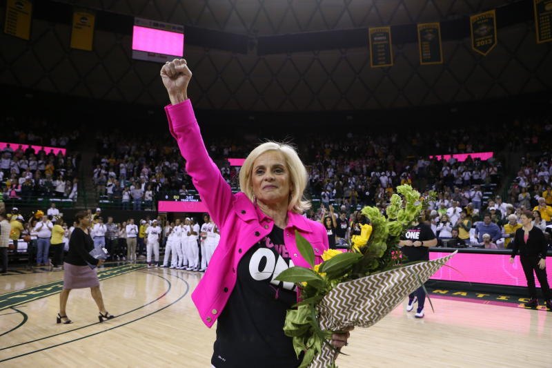 Baylor head coach Kim Mulkey thanks the fans as she is is congratulated for her 600 wins before an NCAA college basketball game against Oklahoma, Saturday, Feb. 22, 2020, in Waco, Texas. (AP Photo/ Jerry Larson)