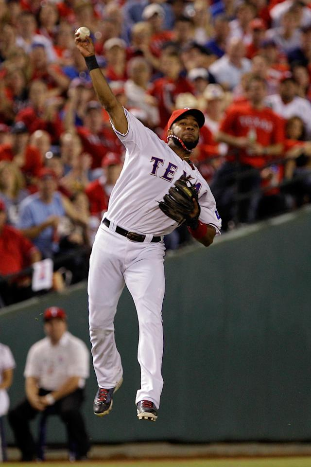 ARLINGTON, TX - OCTOBER 24: Elvis Andrus #1 of the Texas Rangers throws to first base after fielding a hit by Yadier Molina #4 of the St. Louis Cardinals in the eighth inning during Game Five of the MLB World Series at Rangers Ballpark in Arlington on October 24, 2011 in Arlington, Texas.  (Photo by Rob Carr/Getty Images)