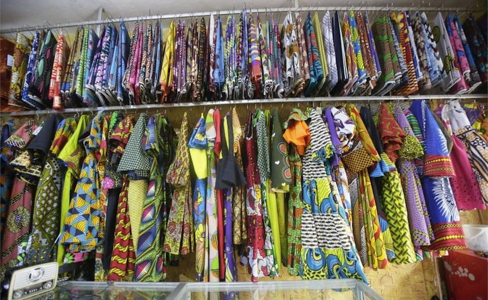 Clothes and fabrics line the wall of a shop in Liberia's capital Monrovia on Monday as lockdown restrictions are eased and businesses reopen.