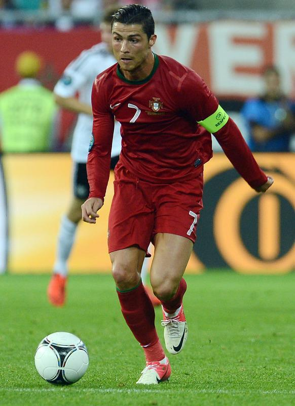 Portuguese forward Cristiano Ronaldo runs with the ball during the Euro 2012 championships football match Germany vs Portugal on June 9, 2012 at the Arena Lviv. AFP PHOTO / PATRIK STOLLARZPATRIK STOLLARZ/AFP/GettyImages
