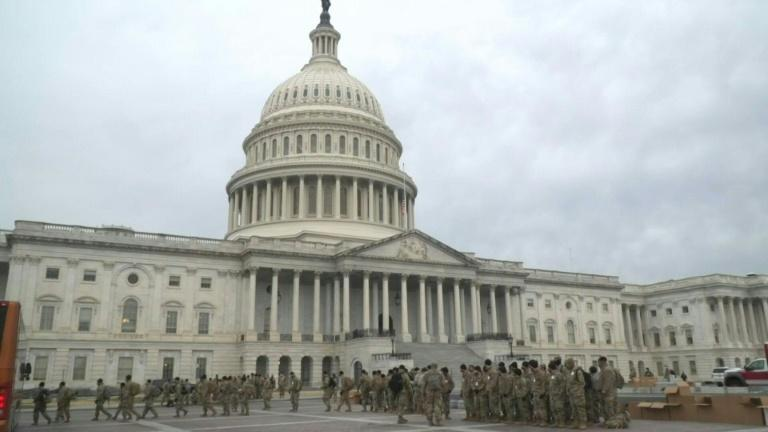 The US Capitol is open to lawmakers and staff, but under tight police and military security