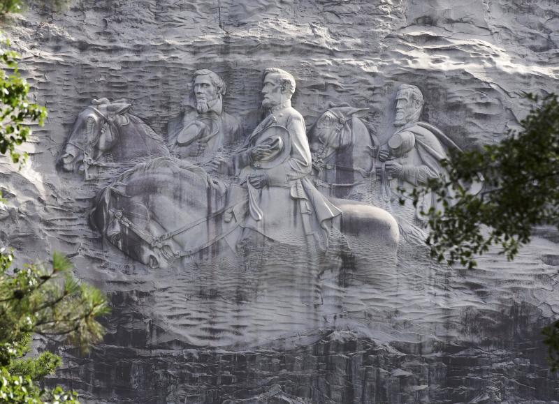 FILE - This June 23, 2015 file photo shows a carving depicting Confederate Civil War figures Stonewall Jackson, Robert E. Lee and Jefferson Davis, in Stone Mountain, Ga. The sculpture is America's largest Confederate memorial. (AP Photo/John Bazemore, File)
