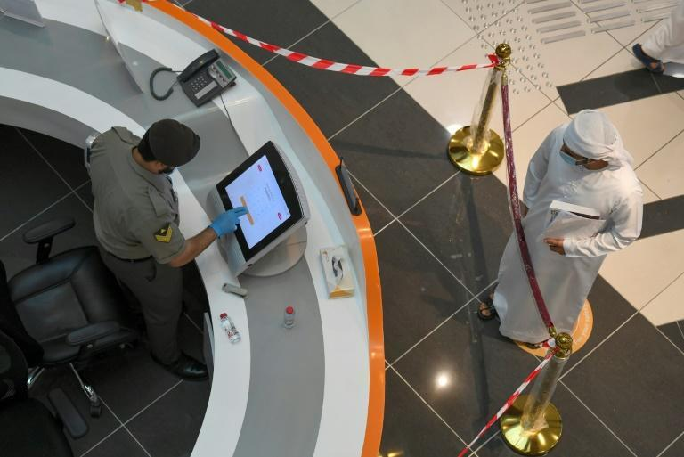 An Emirati man waits to be seen at the Passports Department as civil servants return to work following the easing of lockdown restrictions in Dubai