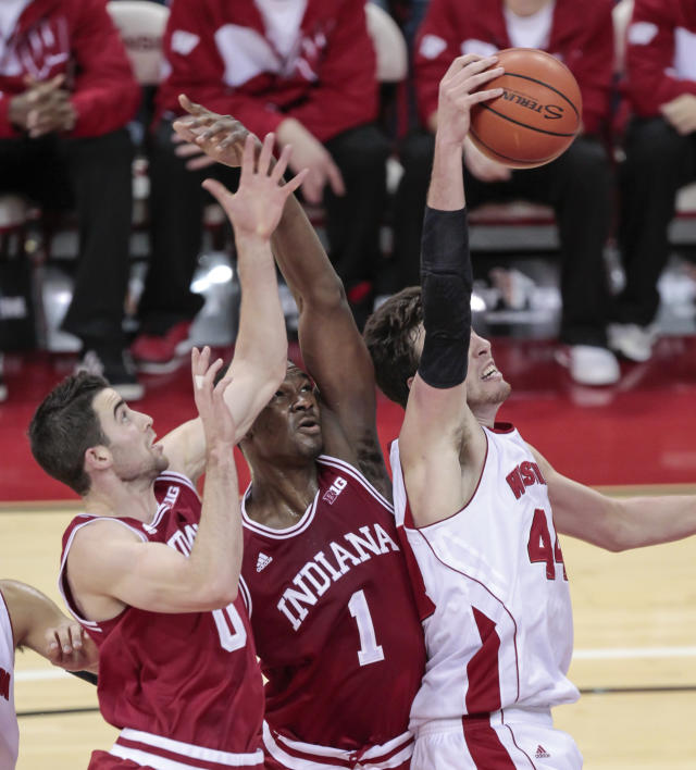 Wisconsin's Frank Kaminsky, right, grabs a defensive rebound away from Indiana's Will Sheehey (0) and Noah Vonleh (1) during the first half of an NCAA college basketball game, Tuesday, Feb. 25, 2014, in Madison, Wis. (AP Photo/Andy Manis)